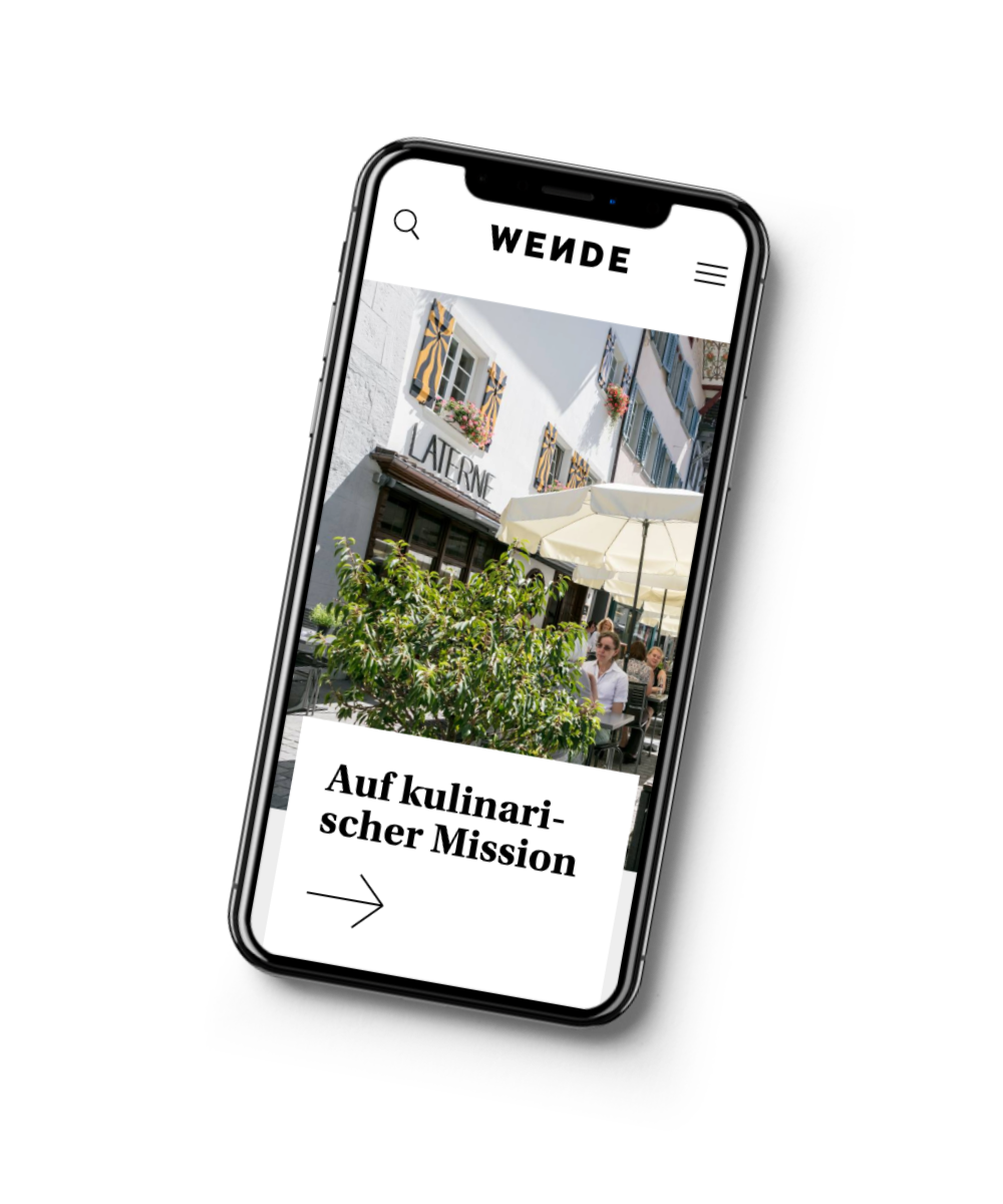 An iPhone that shows the home page of Wende's website